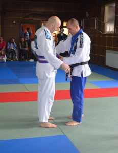 Vieku receiving his belt.